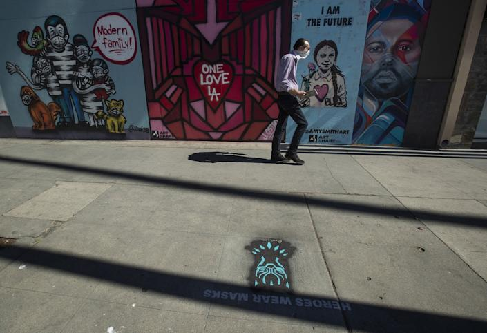 """A Black Panther-themed """"Heroes Wear Masks"""" artwork along Ventura Boulevard in Studio City. <span class=""""copyright"""">(Mel Melcon / Los Angeles Times)</span>"""