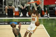 Atlanta Hawks' John Collins dunks during the second half of Game 1 of the NBA Eastern Conference basketball finals game against the Milwaukee Bucks Wednesday, June 23, 2021, in Milwaukee. (AP Photo/Morry Gash)