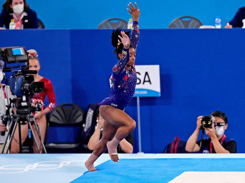 Simone Biles steps off the mat during her floor routine.