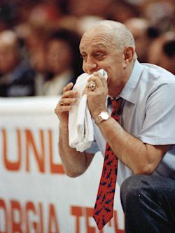 Jerry Tarkanian chews on his towel while watching UNLV play Duke in the 1990 NCAA championship game. (AP)