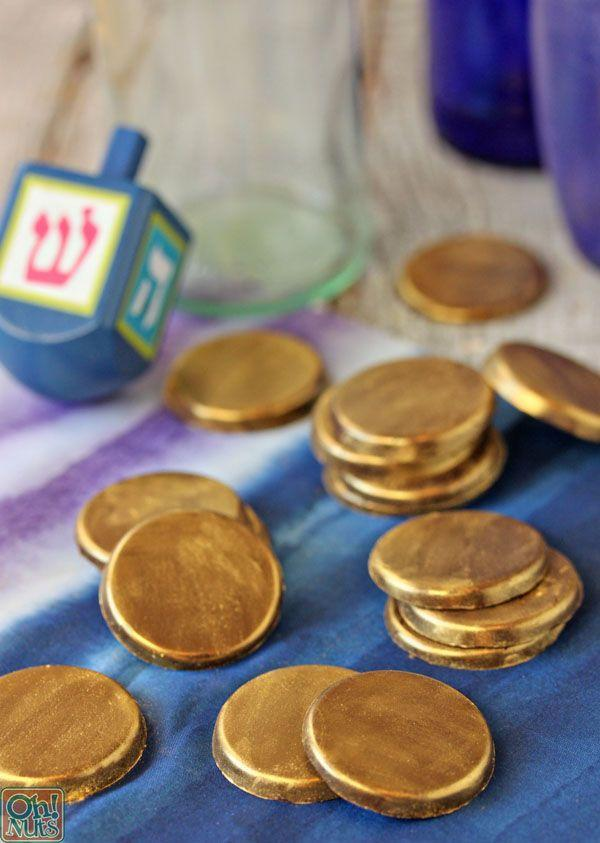 "<p>Sure, it's much easier just to buy the foil-wrapped version. But these handmade chocolate coins are stunning, and require just a few ingredients. Paint on gold luster dust with a food-safe paint brush for a wow-worthy finish.</p><p><em><a href=""http://www.ohnuts.com/blog/hanukkah-gelt/"" rel=""nofollow noopener"" target=""_blank"" data-ylk=""slk:Get the recipe for chocolate gelt"" class=""link rapid-noclick-resp"">Get the recipe for chocolate gelt</a></em></p>"