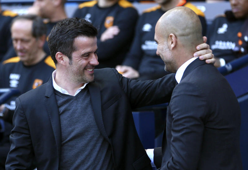 Hull City manager Marco Silva, left, greets Manchester City manager Pep Guardiola before their English Premier League match at the Etihad Stadium, Manchester, England, Saturday, April 8, 2017. (Dave Thompson/PA via AP)