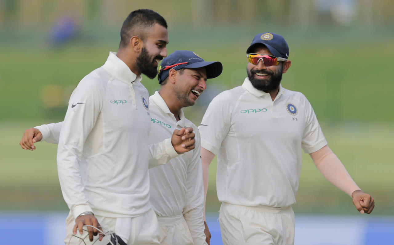<p>India's Kuldeep Yadav, center, shares a laugh with teammates Mohammed Shami, right, and Lokesh Rahul as they leave the ground at the end of Sri Lanka's first innings on the second day's play of their third cricket test match in Pallekele, Sri Lanka, Sunday, Aug. 13, 2017. (AP Photo/Eranga Jayawardena) </p>