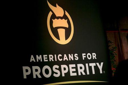 FILE PHOTO: An Americans for Prosperity banner is seen during an event in Manchester, New Hampshire, July 22, 2015.  REUTERS/Dominick Reuter
