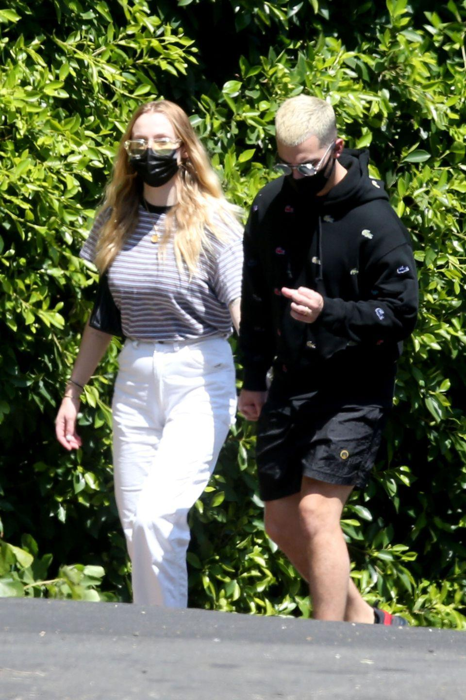 Sophie Turner & Joe Jonas Hold Hands During a Walk After Welcoming Baby Willa