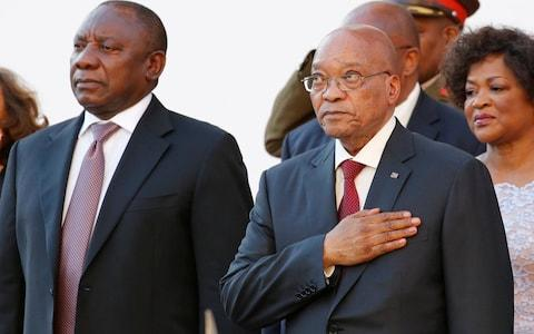 South Africa's President Cyril Ramaphosa, standing next to Jacob Zuma, has pledged to stamp out corruption - Credit: REUTERS/Mike Hutchings