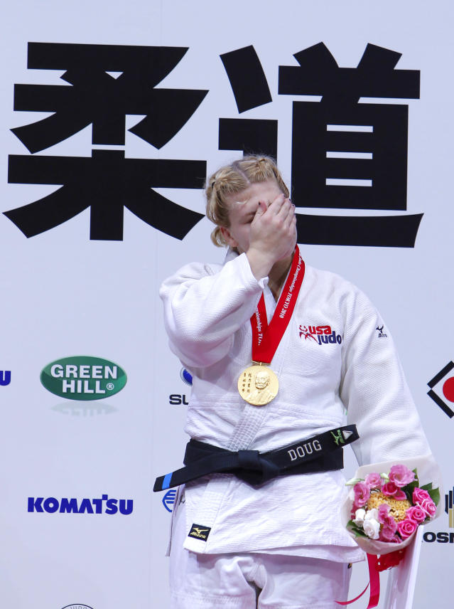 Kayla Harrison of the United States reacts in the awarding ceremony of the women's under 78 Kg category of the World Judo Championships in Tokyo, Thursday, Sept. 9, 2010. Harrison became the first American woman to win a gold medal at the judo world championships since 1984. (AP Photo/Shizuo Kambayashi)