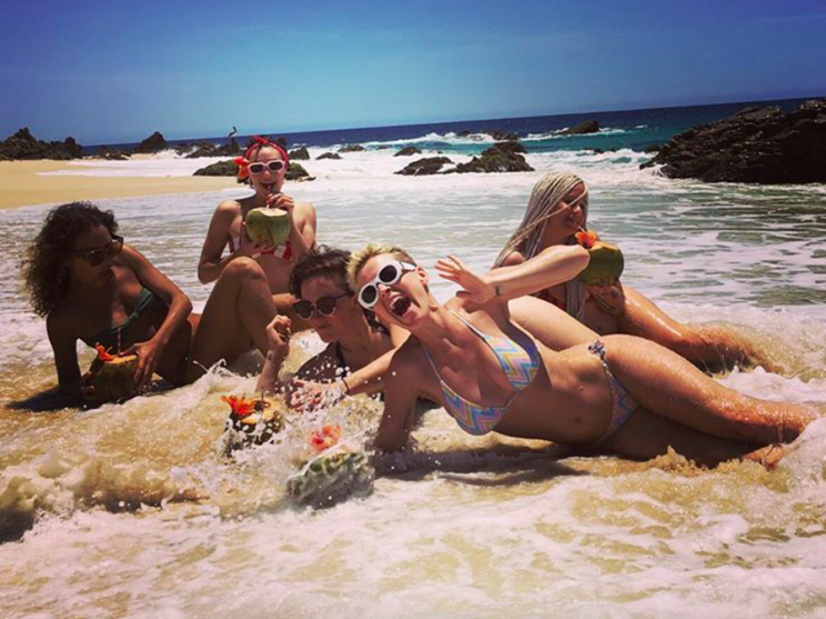 Katy Perry and her girlfriends nearly lost their drinks when a wave crashed their photo op. (Photo: Instagram)