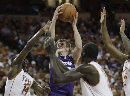 Kansas State Will Spradling, center, shoots as he is defended by Texas' J'Covan Brown, left, and Alexis Wangmene, right, during the first half of an NCAA college basketball game, Saturday, Feb. 11, 2012, in Austin, Texas. (AP Photo/Eric Gay)