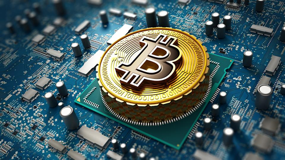 Crypto currency / Blockchain concept with coin on the motherboard.
