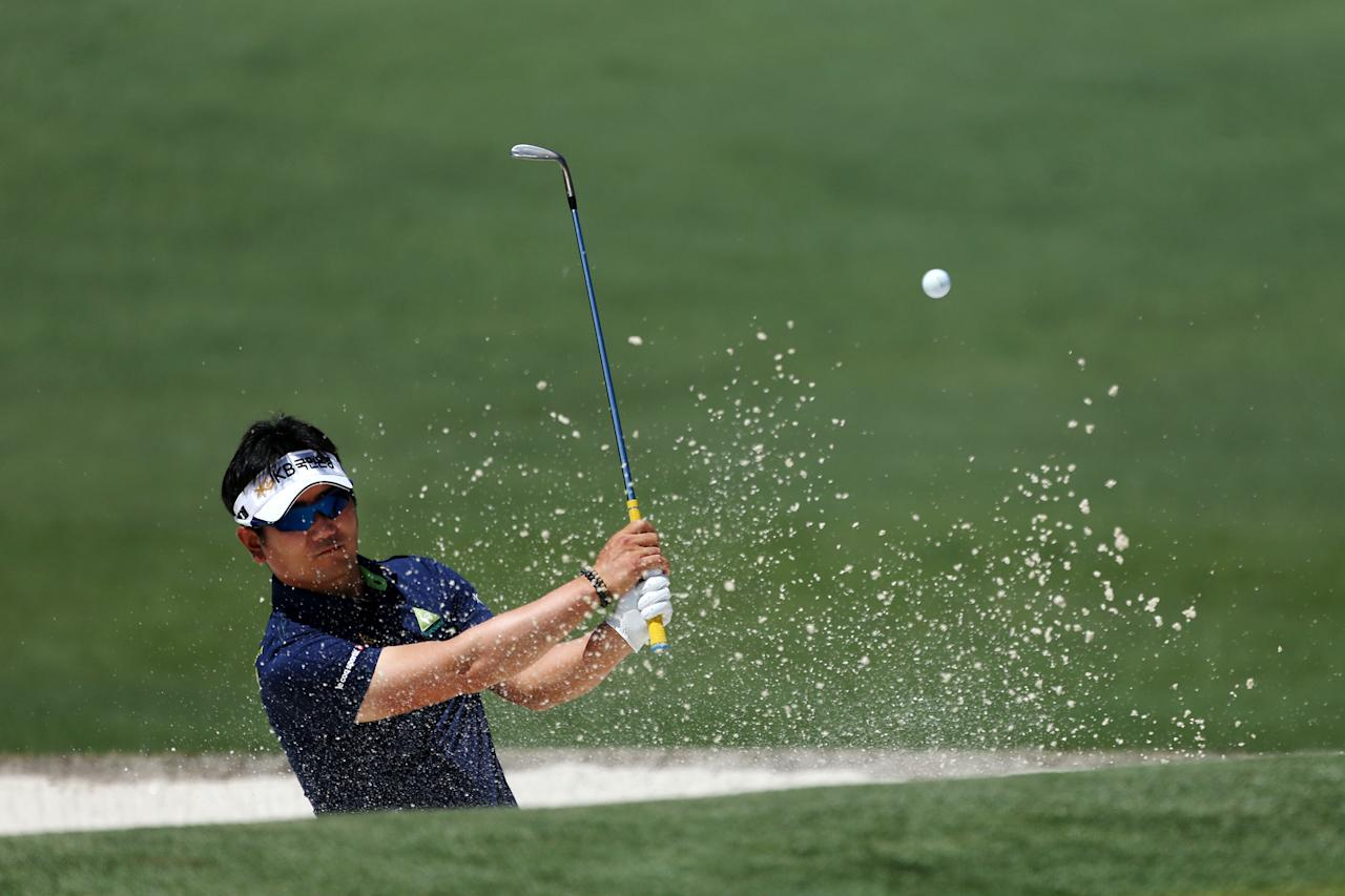 AUGUSTA, GA - APRIL 07:  Y.E. Yang of Korea hits a shot out of the bunker on the second hole during the third round of the 2012 Masters Tournament at Augusta National Golf Club on April 7, 2012 in Augusta, Georgia.  (Photo by Andrew Redington/Getty Images)