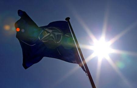FILE PHOTO - A NATO flag flies at the Alliance's headquarters in Brussels