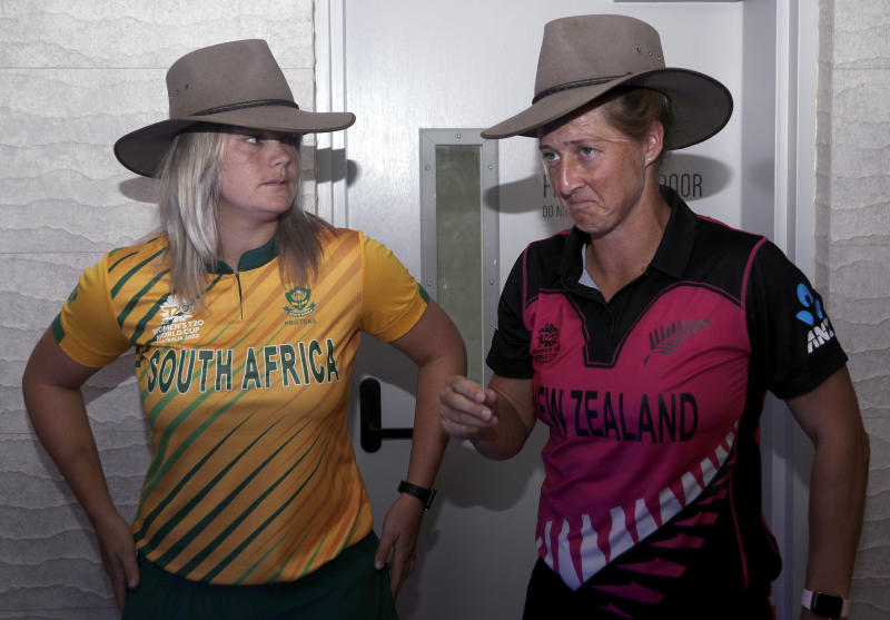 Dane van Niekerk of South Africa, left, and Sophie Devine, of New Zealand try on a traditional Australian hat called an Akubra after a press conference with captains of the 10 countries participating in the Women's T20 World Cup in Sydney, Monday, Feb. 17, 2020. The tournament begins Friday, Feb. 21. (AP Photo/Rick Rycroft)