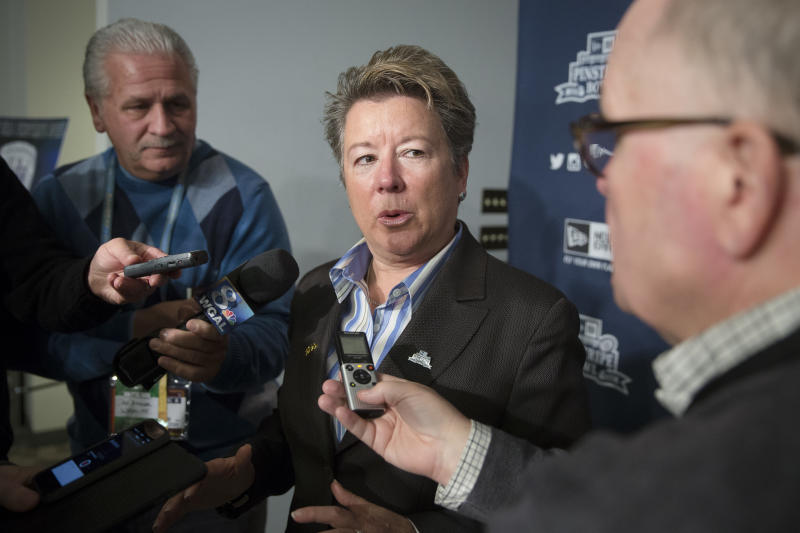 Penn State athletic director Sandy Barbour takes questions from reporters after a news conference at Yankee Stadium regarding the upcoming Pinstripe Bowl between Penn State and Boston College, Tuesday, Dec. 9, 2014, in the Bronx borough of New York.. (AP Photo/John Minchillo)