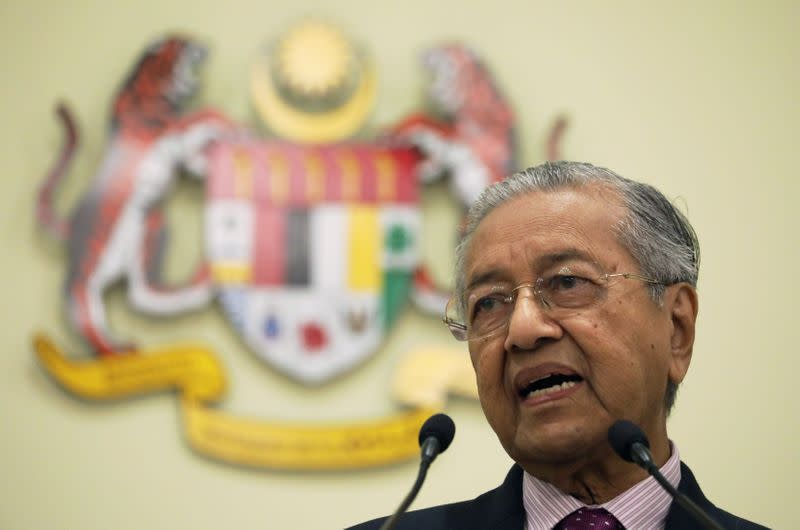 Malaysia's Interim Prime Minister Mahathir Mohamad speaks during a news conference in Putrajaya