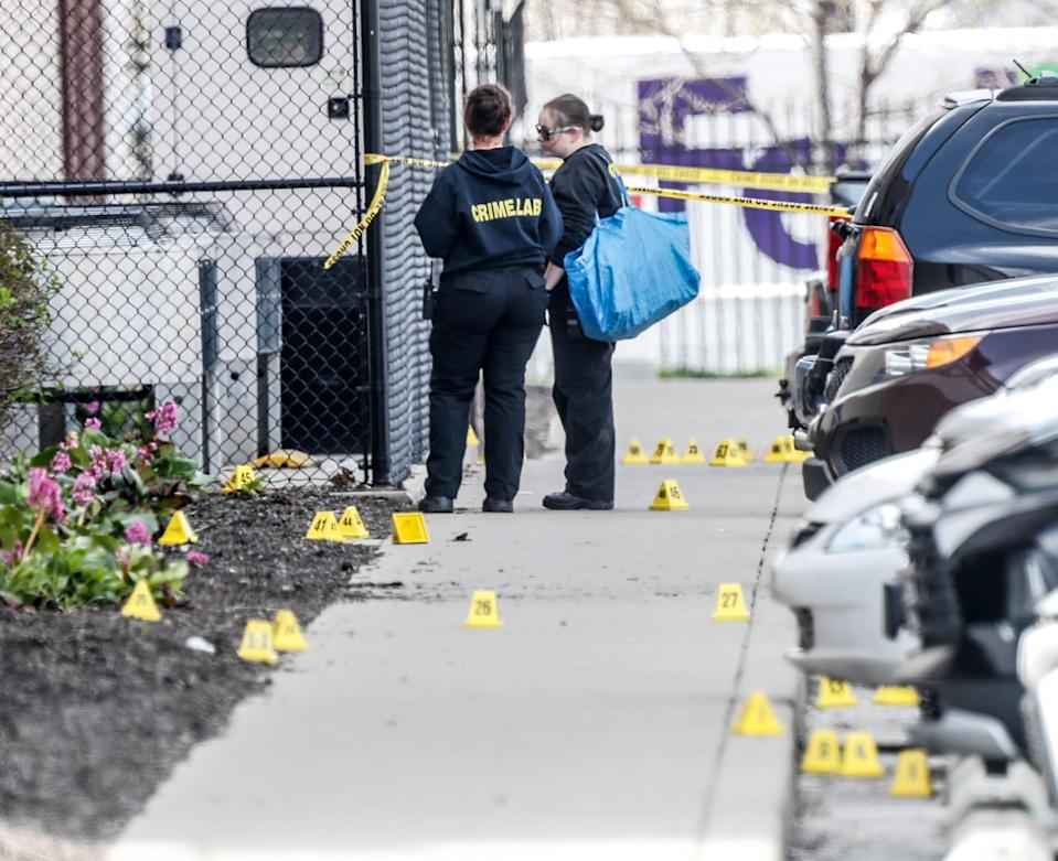 Investigators work the scene of a mass shooting at a FedEx facility on Friday, April 16, 2021, in Indianapolis. The shooting took place late Thursday evening at the FedEx Ground Facility near the Indianapolis International Airport.