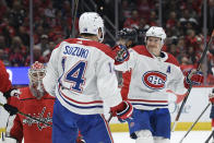 CORRECTS GOALIE TO ILYA SAMSONOV, INSTEAD OF BRADEN HOLTBY - Montreal Canadiens center Nick Suzuki (14) celebrates his goal with right wing Brendan Gallagher, right, during the second period of an NHL hockey game, against Washington Capitals goaltender Ilya Samsonov, lower left, Friday, Nov. 15, 2019, in Washington. (AP Photo/Nick Wass)