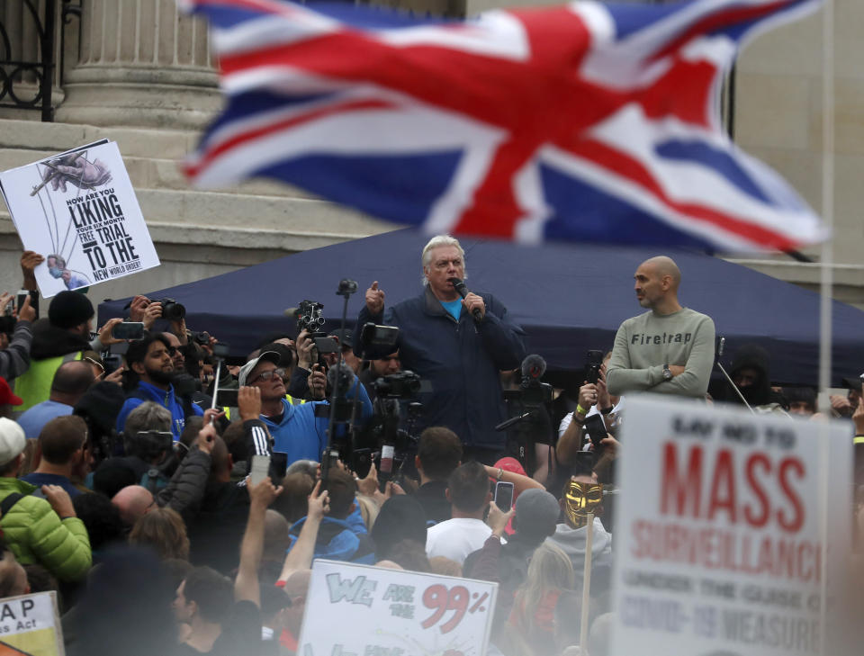 English conspiracy theorist David Icke speaks during a 'We Do Not Consent' rally at Trafalgar Square, organised by Stop New Normal, to protest against coronavirus restrictions, in London, Saturday, Sept. 26, 2020. (AP Photo/Frank Augstein)