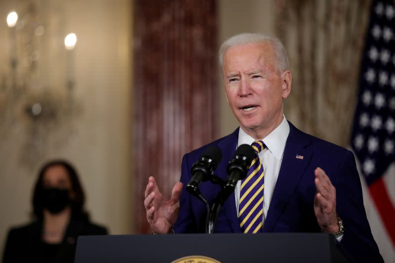 FILE PHOTO: U.S. President Joe Biden delivers a foreign policy address as Vice President Kamala Harris listens, at the State Department in Washington