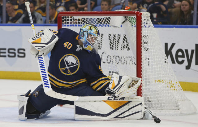 Buffalo Sabres goalie Carter Hutton (40) makes a save during the second period of an NHL hockey game against the Vegas Golden Knights, Monday, Oct. 8, 2018, in Buffalo N.Y. (AP Photo/Jeffrey T. Barnes)