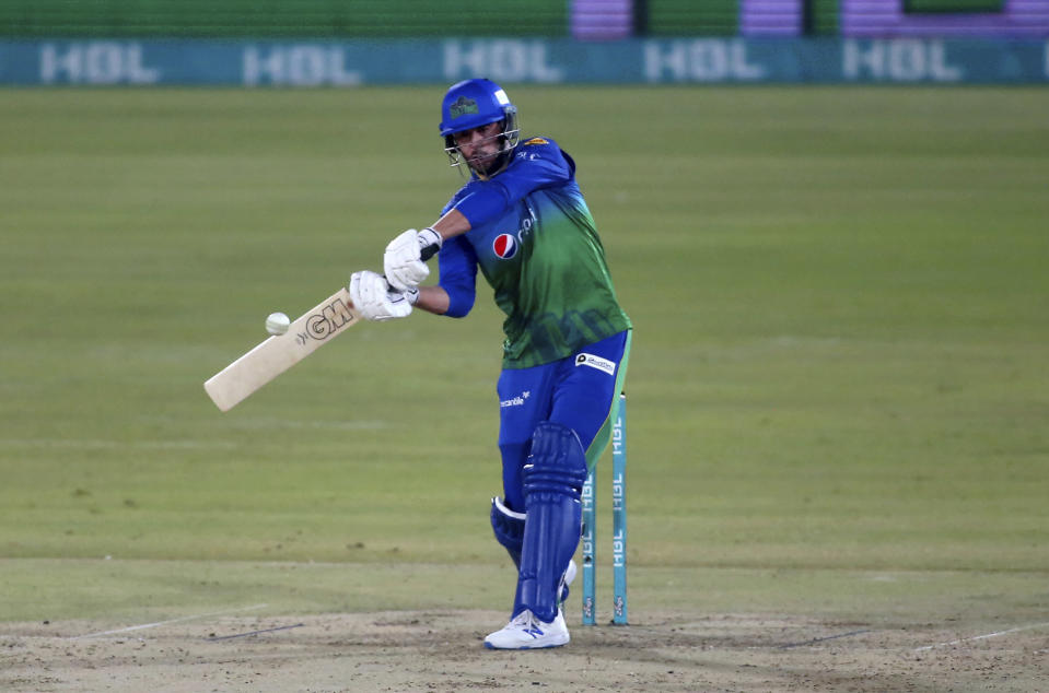 Multan Sultans' James Vince plays a shot during a Pakistan Super League T20 cricket match between Multan Sultans and Peshawar Zalmi at the National Stadium, in Karachi, Pakistan, Tuesday, Feb. 23, 2021. (AP Photo/Fareed Khan),