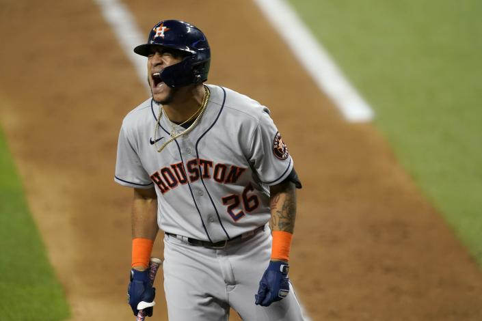 Houston Astros' Jose Siri shouts after on the left hand by a pitch from Texas Rangers' Jordan Lyles during the fifth inning of a baseball game in Arlington, Texas, Tuesday, Sept. 14, 2021. Siri stayed in the game. (AP Photo/Tony Gutierrez)