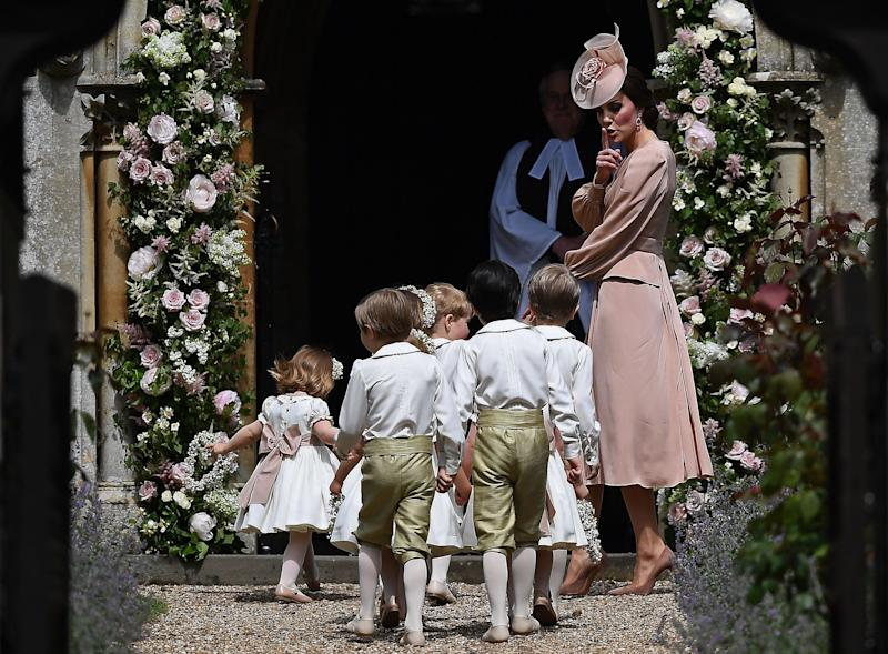 Catherine, Duchess of Cambridge walks with the bridesmaids and pageboys as they arrive for her sister's wedding to James Matthews.