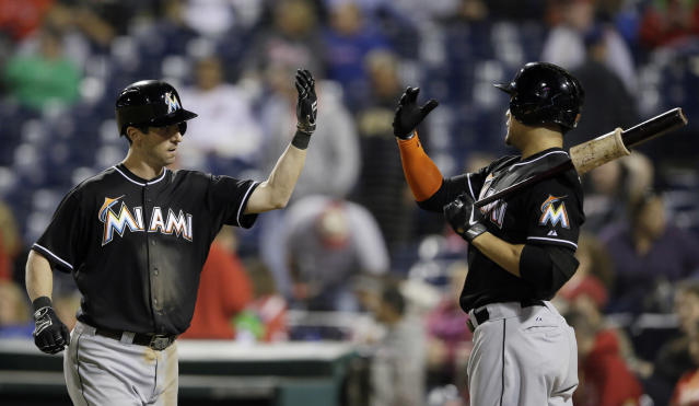 Miami Marlins' Ed Lucas, left, and Giancarlo Stanton celebrate after Lucas' home run during the 10th inning of a baseball game against the Philadelphia Phillies, Wednesday, Sept. 18, 2013, in Philadelphia. Miami won 4-3 in 10 innings. (AP Photo/Matt Slocum)