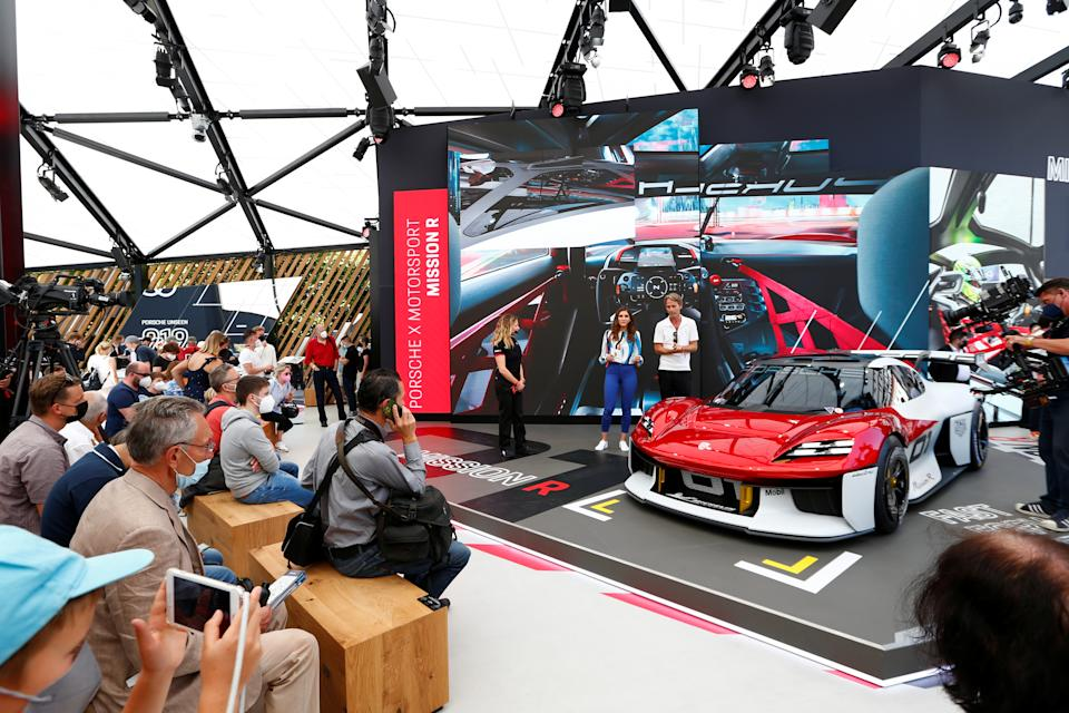People look at a Porsche Mission R during the Munich Auto Show, IAA Mobility 2021 in Munich, Germany, September 8, 2021. REUTERS/Michaela Rehle