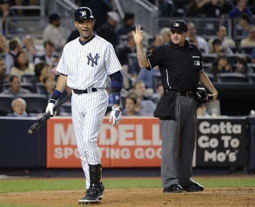 Home plate umpire Dan Bellino calls a third strike on New York Yankees' Derek Jeter during the third inning of a baseball game against the Oakland Athletics on Friday, Sept. 21, 2012, at Yankee Stadium in New York. (AP Photo/Kathy Kmonicek)
