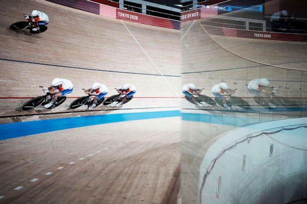 PHOTO: Members of the French women's track cycling team round the track during a training session inside the Izu velodrome at the 2020 Summer Olympics, Saturday, July 31, 2021, in Izu, Japan. (Thibault Camus/AP Photo)