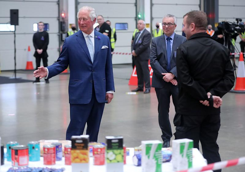 Britain's Prince Charles, Prince of Wales (L) shares a joke with driver Stephen Taggart (R) during a visit to Henderson Foodservice's food and grocery distribution centre in Newtownabbey, near Belfast, on September 30, 2020, where he thanked them for their efforts during the COVID-19 pandemic, and coping with the unprecedented demand they faced in recent months. (Photo by Niall Carson / POOL / AFP) (Photo by NIALL CARSON/POOL/AFP via Getty Images)