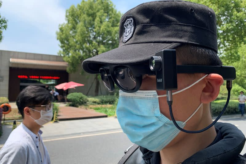 Security guard wearing thermal glasses developed by Chinese company Rokid poses in Hangzhou
