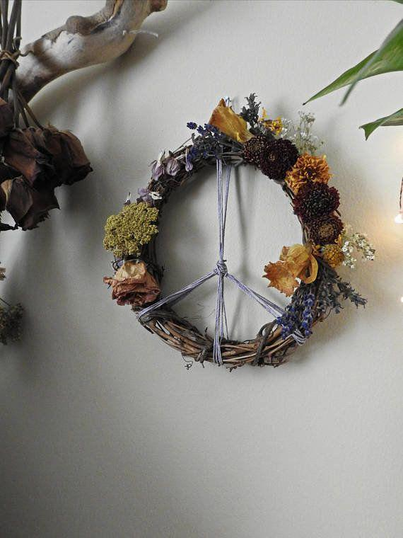 """<a href=""""https://www.etsy.com/listing/558128947/botanical-peace-sign-wreath-flowers?ref=shop_home_active_1"""" target=""""_blank"""">Shop it here</a>."""