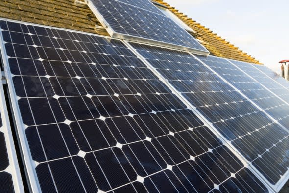 Architecture, Alternative Energy, Electricity, Solar photovoltaic roof panels on detached house for electricity conversion....