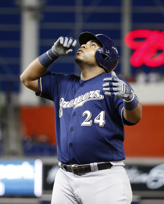 Milwaukee Brewers' Jesus Aguilar celebrates after getting a base hit during the fourth inning of the team's baseball game against the Miami Marlins, Wednesday, July 11, 2018, in Miami. (AP Photo/Wilfredo Lee)