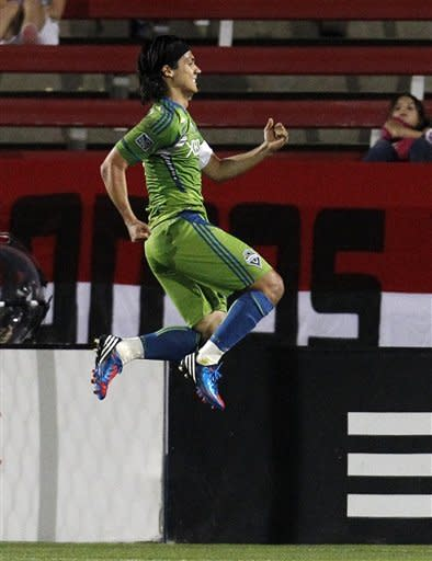 Seattle Sounders forward Fredy Montero celebrates his second goal in the second half of an MLS soccer game against FC Dallas on Wednesday, May 9, 2012, in Frisco, Texas. Montero scored twice in a 3-minute span to lead the Sounders to their fifth consecutive victory, 2-0. (AP Photo/Tony Gutierrez)