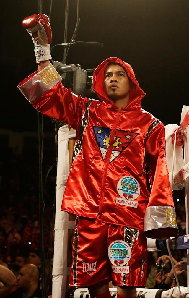 HOUSTON, TX - DECEMBER 15: Nonito Donaire of the Philippines waves to the crowd before his WBO World Super Bantamweight bout with Jorge Arce of Mexico at the Toyota Center on December 15, 2012 in Houston, Texas. (Photo by Scott Halleran/Getty Images)
