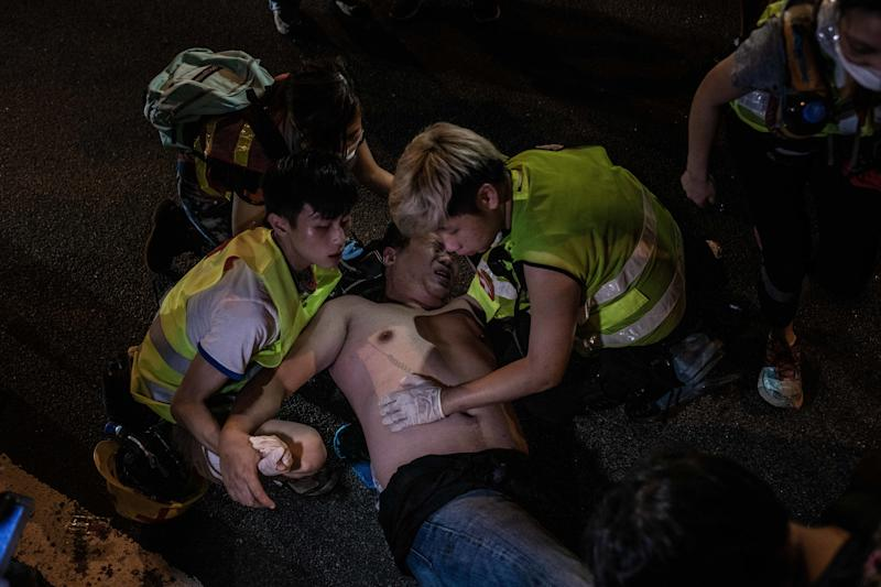 A man who tried to break a blockage of barricades in Central was attacked by protesters. Paramedics attended the man after he felt unconscious. (Photo: Ivan Abreu/SOPA Images/LightRocket via Getty Images)