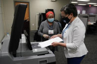 Democratic gubernatorial candidate, Virginia State Sen. Jennifer McClellan, inserts her ballot in a voting machine at an early voting location in Richmond, Va., Saturday, May 29, 2021. McClellan faces four other Democrats in the primary. (AP Photo/Steve Helber)