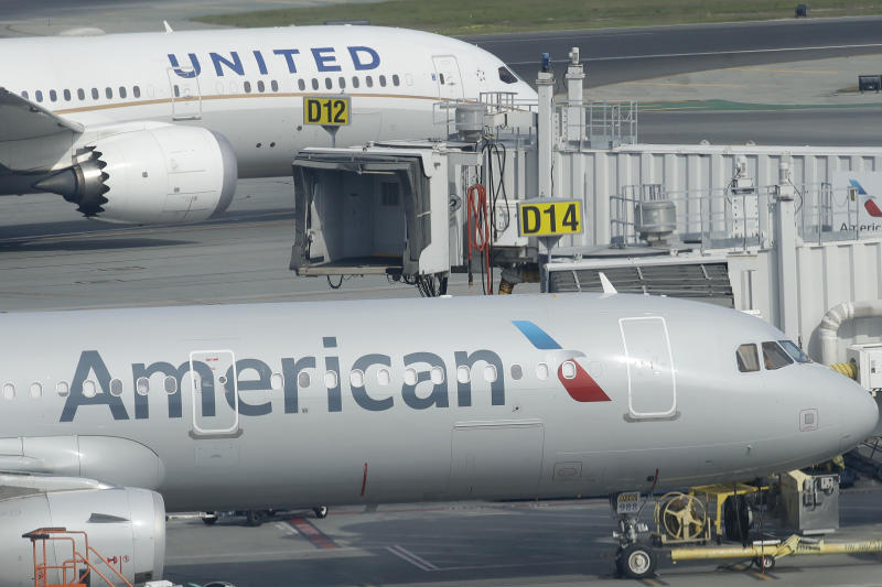 United Airlnes and American Airlnes planes are shown on the tarmac from an outdoor terrace and observation deck at San Francisco International Airport in San Francisco, Thursday, Feb. 20, 2020. (AP Photo/Jeff Chiu)
