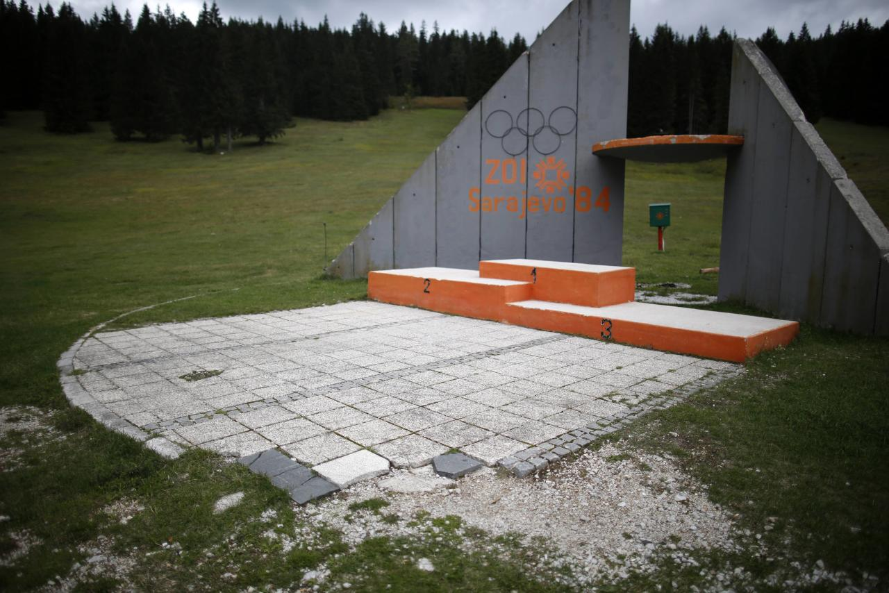 REFILE CORRECTING TYPO IN SARAJEVO   A view of the derelict medals podium at the disused ski jump from the Sarajevo 1984 Winter Olympics on Mount Igman, near Sarajevo September 19, 2013. Abandoned and left to crumble into oblivion, most of the 1984 Winter Olympic venues in Bosnia's capital Sarajevo have been reduced to rubble by neglect as much as the 1990s conflict that tore apart the former Yugoslavia. The bobsleigh and luge track at Mount Trebevic, the Mount Igman ski jumping course and accompanying objects are now decomposing into obscurity. The bobsleigh and luge track, which was also used for World Cup competitions after the Olympics, became a Bosnian-Serb artillery stronghold during the war and is nowadays a target of frequent vandalism. The clock is now ticking towards the 2014 Winter Olympics, with October 29 marking 100 days to the opening of the Games in the Russian city of Sochi. Picture taken on September 19, 2013. REUTERS/Dado Ruvic (BOSNIA AND HERZEGOVINA - Tags: SOCIETY SPORT OLYMPICS SKIING TPX IMAGES OF THE DAY)  ATTENTION EDITORS: PICTURE 22 OF 23 FOR PACKAGE 'SARAJEVO'S WINTER OLYMPIC LEGACY'. TO FIND ALL IMAGES SEARCH 'DADO IGMAN'