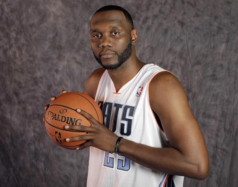 Charlotte Bobcats' Al Jefferson poses for a photo during the NBA basketball team's media day in Charlotte, N.C., Monday, Sept. 30, 2013. (AP Photo/Chuck Burton)