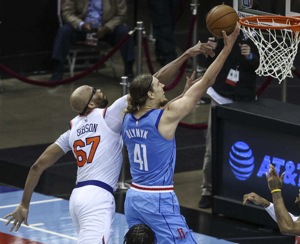 Houston Rockets forward Kelly Olynyk (41) shoots the ball as New York Knicks center Taj Gibson (67) defends during the second quarter of an NBA basketball game in Houston, Sunday, May 2, 2021. (Troy Taormina/Pool Photo via AP)