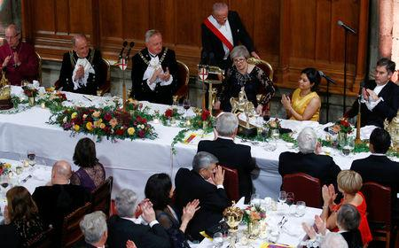 Britain's Prime Minister Theresa May is applauded after delivering a speech during the annual Lord Mayor's Banquet at Guildhall in London, Britain, November 12, 2018. REUTERS/Henry Nicholls