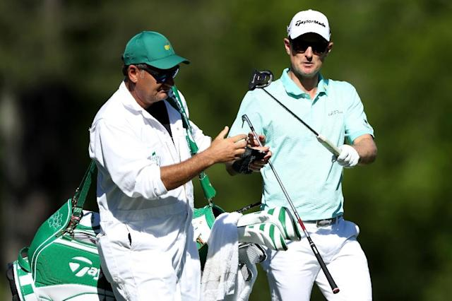 Justin Rose (R) birdied five of the last seven holes to shoot 67 in ideal conditions and join Sergio Garcia in the lead entering the last round of the 2017 Masters Tournament (AFP Photo/David CANNON)