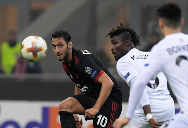 AC Milan's midfielder Hakan Calhanoglu (L) vies for the ball during a UEFA Europa League group D football match against FK Austria-Wiendur (AFP Photo/MIGUEL MEDINA)