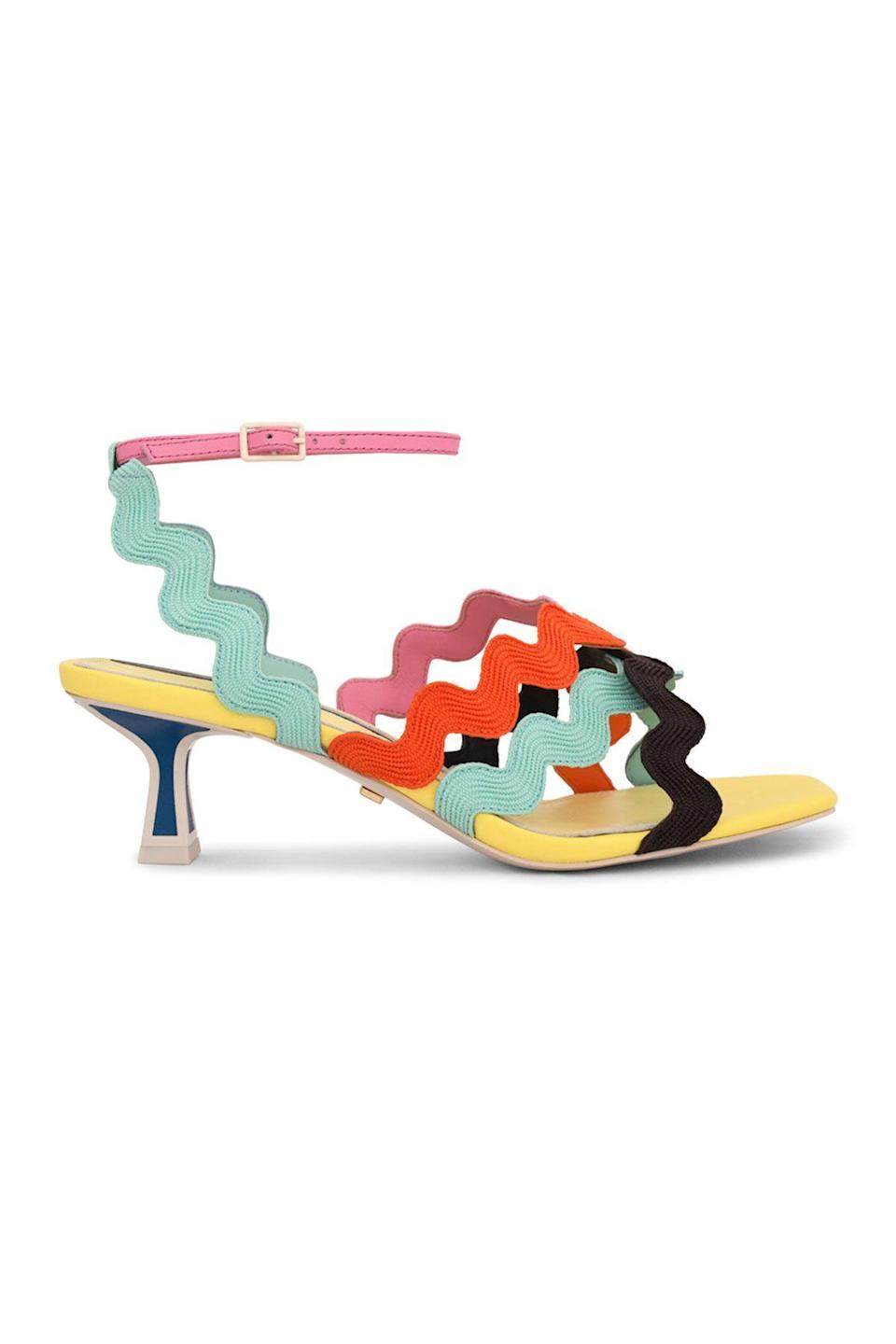 """<p><strong>Kat Maconie</strong></p><p>neimanmarcus.com</p><p><strong>$308.00</strong></p><p><a href=""""https://go.redirectingat.com?id=74968X1596630&url=https%3A%2F%2Fwww.neimanmarcus.com%2Fp%2Fkat-maconie-multicolored-wavy-strap-kitten-heel-sandals-prod239550355&sref=https%3A%2F%2Fwww.townandcountrymag.com%2Fstyle%2Ffashion-trends%2Fg36474527%2Fstatement-heels%2F"""" rel=""""nofollow noopener"""" target=""""_blank"""" data-ylk=""""slk:Shop Now"""" class=""""link rapid-noclick-resp"""">Shop Now</a></p><p>The '70s are back, Baby! These groovy sandals are ready to hit the dance floor. </p>"""
