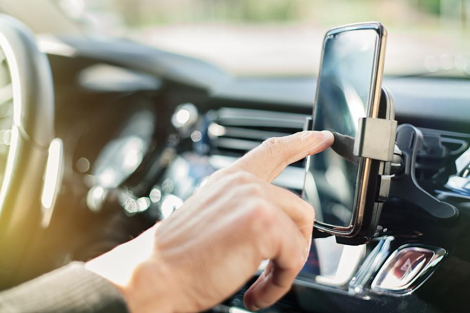 The committee of MPs said hands-free usage posed the same risk of collision as handheld devices (Picture: Getty)