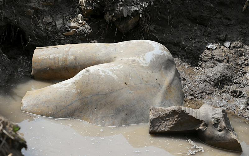 A statue workers say depicts Pharaoh Ramses II who ruled Egypt over 3,000 years was unearthed on Thursday in the Matariya area in Cairo - Reuters